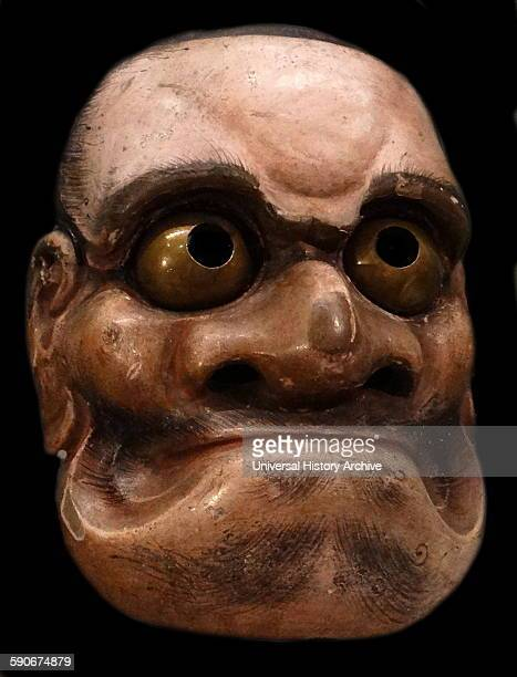 Noh mask representing the notorious bandit of legends Kumasaka Carved from blocks of Japanese cypress and painted with natural pigments on a neutral...