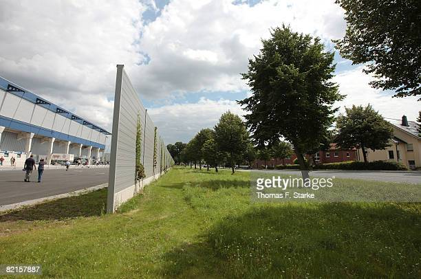 A noise protection wall is seen between the stadium and the residents houses ahead of the 3 Bundesliga match between SC Paderborn and SpVgg...