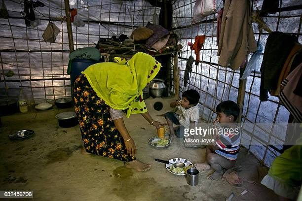 COX'S BAZAR BANGLADESH JANUARY 20 Nojiba feeds her children in her makeshift house that she shares with 14 other refugees on January 20 2017 in...
