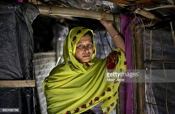 COX'S BAZAR BANGLADESH JANUARY 20 Nojiba poses for a photo in her makeshift house that she shares with 14 other refugees on January 20 2017 in...