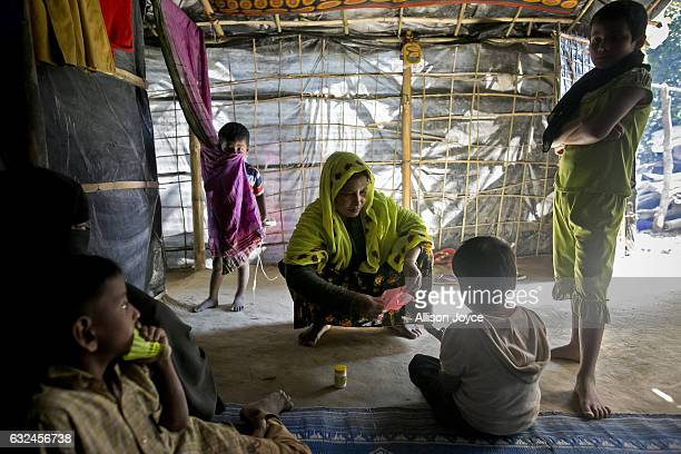 COX'S BAZAR BANGLADESH JANUARY 20 Nojiba sits with friends and family members in her makeshift house that she shares with 14 other refugees on...