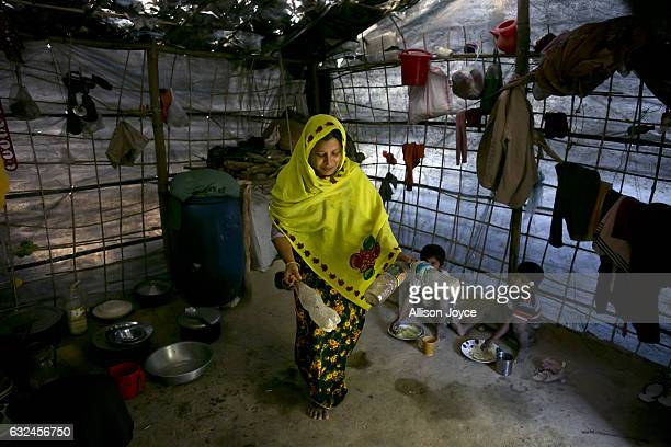 COX'S BAZAR BANGLADESH JANUARY 20 Nojiba sweeps the floor of her makeshift house that she shares with 14 other refugees on January 20 2017 in...