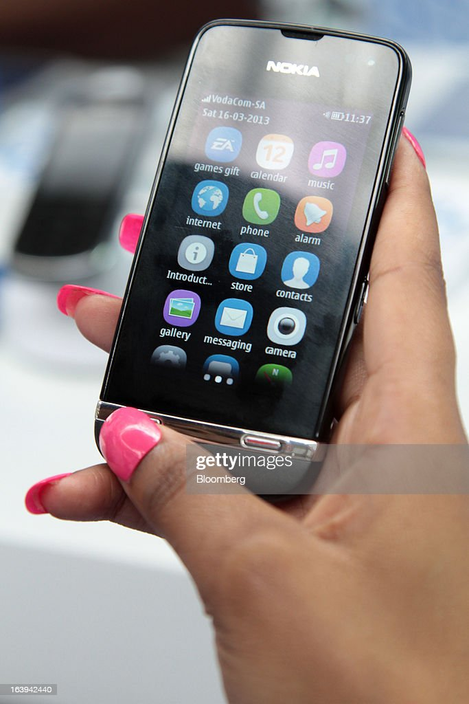 A Nokia Asha 311 smartphone is seen during a promotional event by Nokia Oyj in Maponya Mall in Soweto, South Africa, on Saturday, March 16, 2013. Nokia, based in Espoo, Finland, introduced three phones for its Asha line, sold primarily in emerging markets. Photographer: Nadine Hutton/Bloomberg via Getty Images
