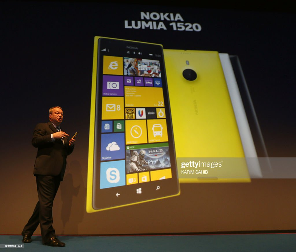 Nokia CEO, Canadian Stephen Elop, unveils the Nokia Lumia 1520 (displayed on the giant screen) during an event on October 22, 2013 in Abu Dhabi. Nokia has unveiled its first phablets -extra-large phones- and its first tablet computer.