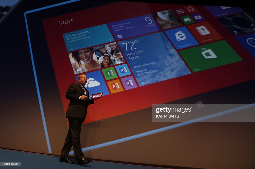 Nokia CEO, Canadian Stephen Elop, unveils the Nokia Lumia 2520 (displayed on the giant screen) during an event on October 22, 2013 in Abu Dhabi. Nokia has unveiled its first phablets -extra-large phones- and its first tablet computer.