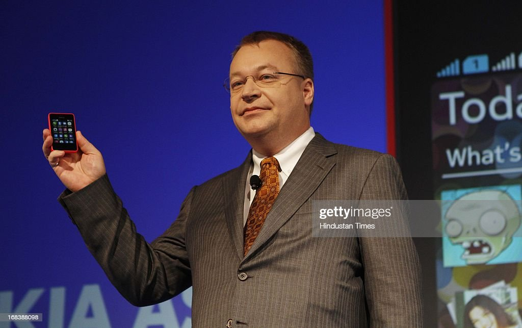 Nokia CEO Stephen Elop holds the Nokia Asha 501 smartphone during its launch on May 9, 2013 in New Delhi, India. Asha 501 is the first device to run on the new Asha platform and the company chose India to launch this low-cost smartphone device globally.