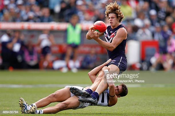 Nokia Cockatoo of the Cats tackles Nat Fyfe of the Dockers during the round two AFL match between the Geelong Cats and the Fremantle Dockers at...