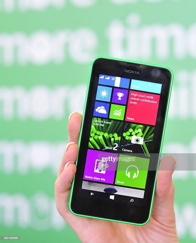 A Nokia employee displays a new Nokia Lumia 635 at More Lumia a media event in San Francisco California on Wednesday April 2 2014 Nokia announced the...
