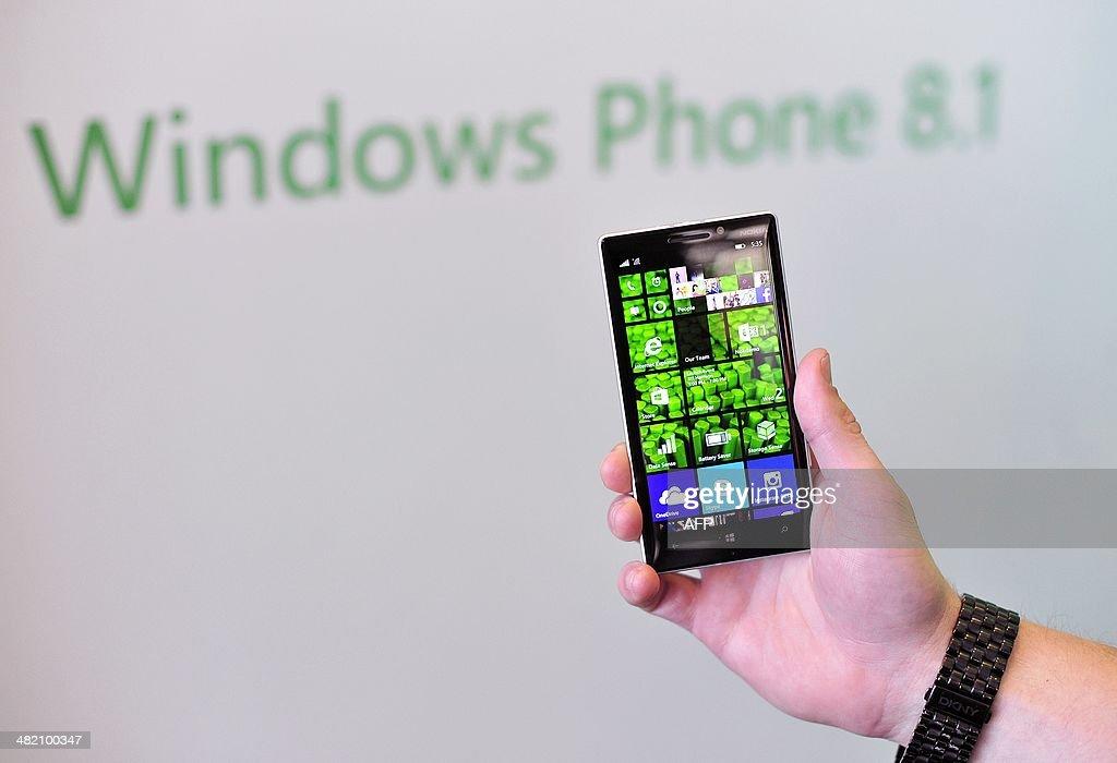 A Nokia employee displays a new Nokia Lumia 930 at More Lumia a media event in San Francisco California on Wednesday April 2 2014 Nokia announced the...