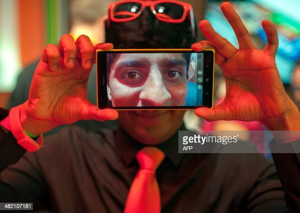 Nokia employee Raghunath Koduvayur poses for a photo with a new Nokia Lumia 1520 smart phone at the More Lumia media event in San Francisco...