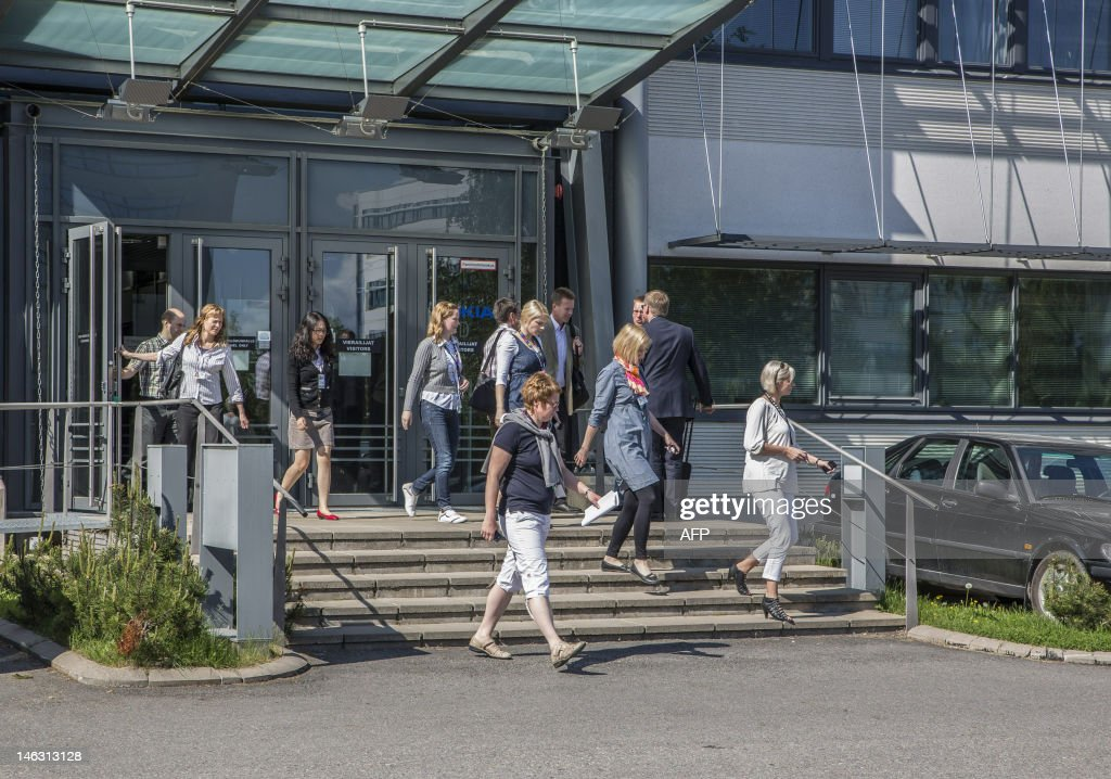 Nokia employees leave after a personnel briefing in Tampere, Finland, on June 14, 2012. Nokia plans to make 3700 workers in Finland redundant by the end of 2013 and phase-out operations in Salo. Finland's Nokia, one of the world's biggest mobile phone makers, announced Thursday that it planned to cut up to 10,000 jobs by the end of next year due to massive additional cost-savings measures. AFP PHOTO / LEHTIKUVA - Jukka Töyli