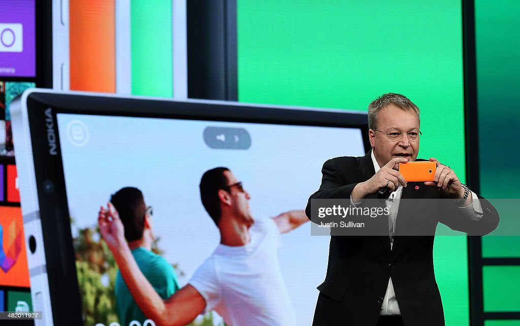 Nokia executive vice president <a gi-track='captionPersonalityLinkClicked' href=/galleries/search?phrase=Stephen+Elop&family=editorial&specificpeople=7180953 ng-click='$event.stopPropagation()'>Stephen Elop</a> takes a picture using the new Nokia Lumia 930 smartphone as he speaks during a keynote address during the 2014 Microsoft Build developer conference on April 2, 2014 in San Francisco, California. The 2014 Microsoft Build developer conference runs through April 4.