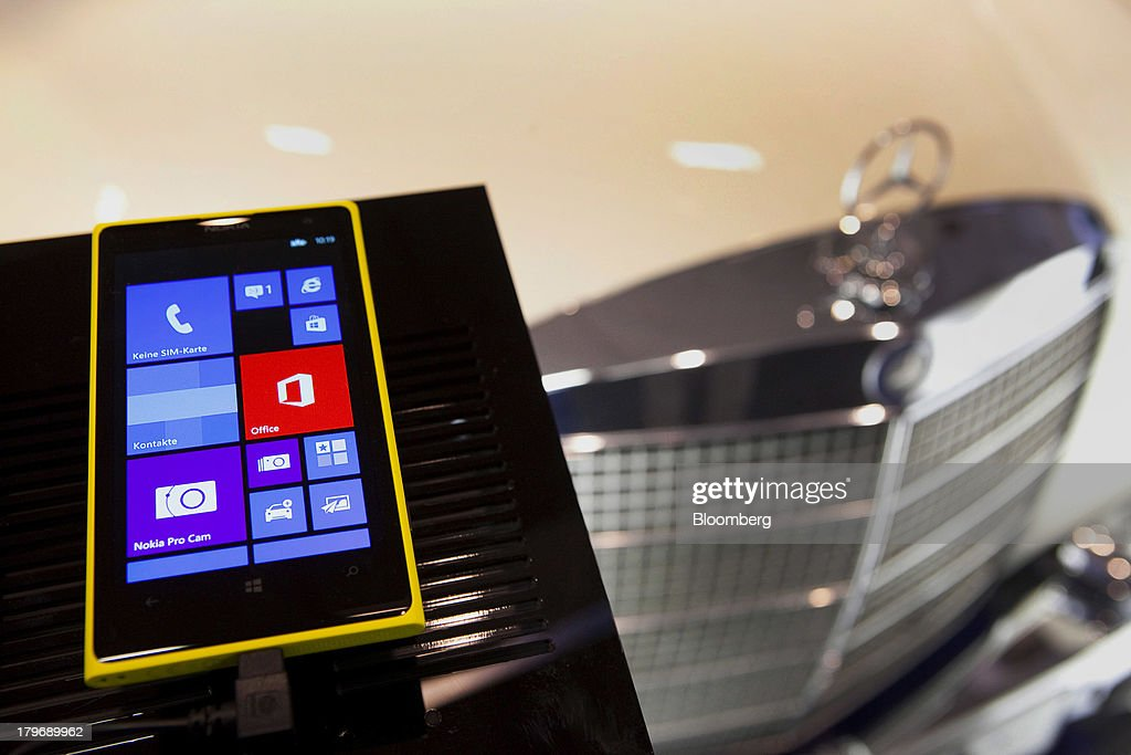 A Nokia Oyj Lumina 1020 mobile phone is displayed next to a Daimler AG Mercedes-Benz vehicle at the IFA consumer electronics show in Berlin, Germany, on Friday, Sept. 6, 2013. Global smartphone revenue will rise 22 percent in 2013, or nearly half the pace of an expected 41 percent gain in shipments, amid falling prices, according to UBS. Photographer: Krisztian Bocsi/Bloomberg via Getty Images