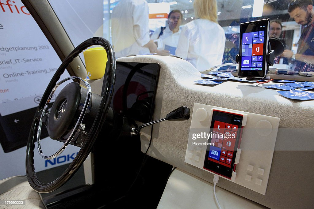 Nokia Oyj Lumina 1020 mobile phones are displayed inside of a Daimler AG Mercedes-Benz vehicle at the IFA consumer electronics show in Berlin, Germany, on Friday, Sept. 6, 2013. Global smartphone revenue will rise 22 percent in 2013, or nearly half the pace of an expected 41 percent gain in shipments, amid falling prices, according to UBS. Photographer: Krisztian Bocsi/Bloomberg via Getty Images