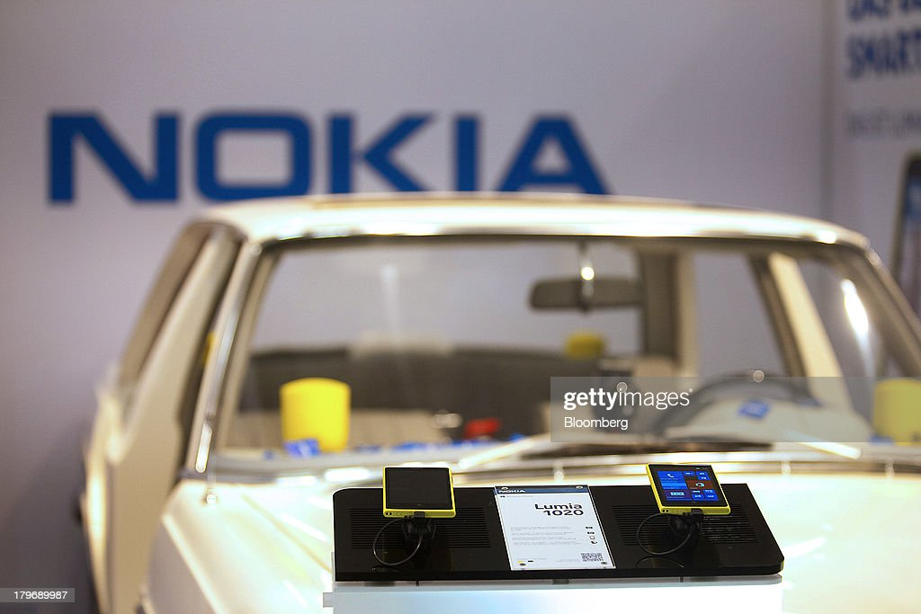 Nokia Oyj Lumina 1020 mobile phones are displayed on top of a Daimler AG Mercedes-Benz vehicle at the IFA consumer electronics show in Berlin, Germany, on Friday, Sept. 6, 2013. Global smartphone revenue will rise 22 percent in 2013, or nearly half the pace of an expected 41 percent gain in shipments, amid falling prices, according to UBS. Photographer: Krisztian Bocsi/Bloomberg via Getty Images