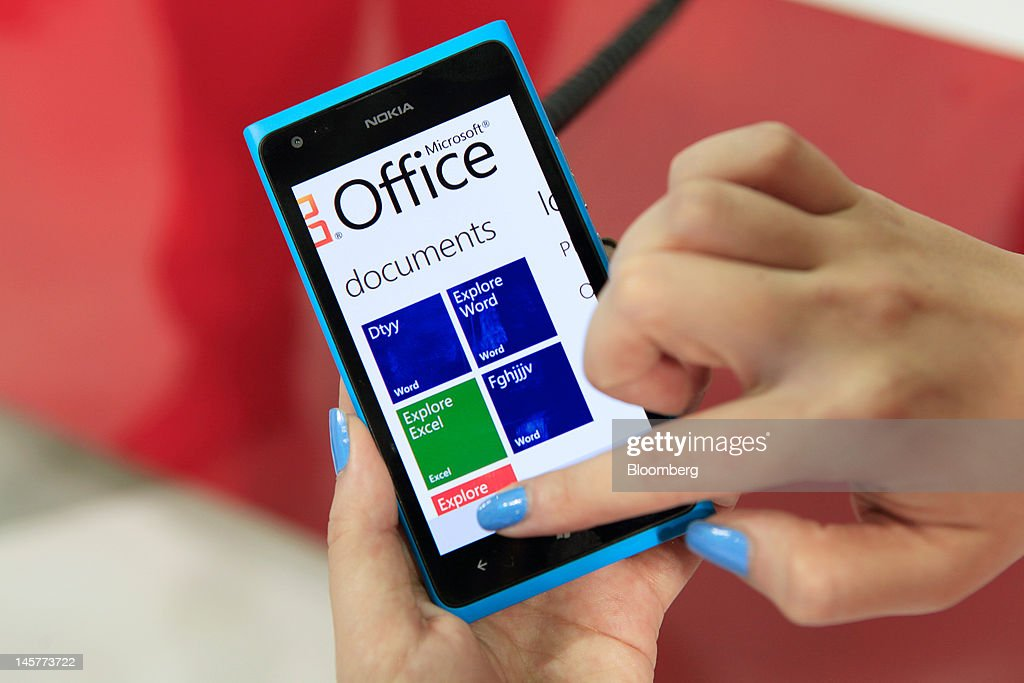 A Nokia Oyj smartphone using Microsoft Corp.'s operating system is displayed in the Microsoft booth at the Computex Taipei 2012 expo in Taipei, Taiwan, on Tuesday, June 5, 2012. Computex Taipei 2012 takes place from June 5 to June 9. Photographer: Ashley Pon/Bloomberg via Getty Images