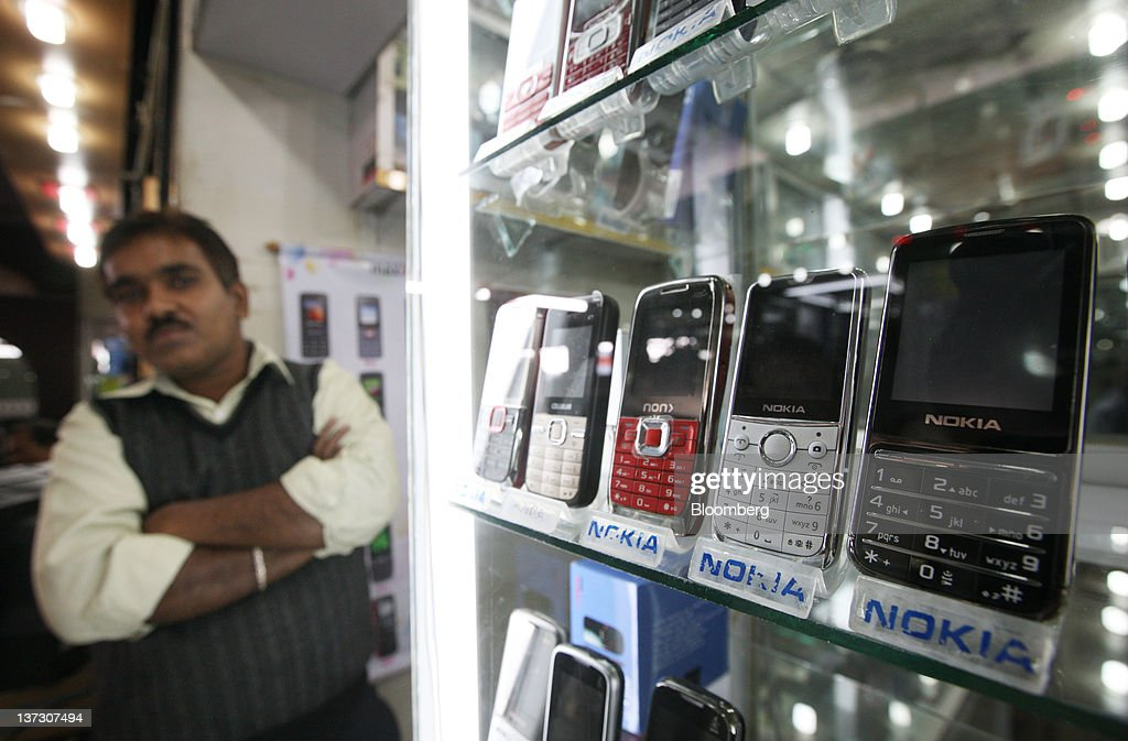 Nokia Oyj smartphones are displayed at an electronics store in Chittagong, Bangladesh, on Saturday, Jan. 14, 2011. Bangladesh's central bank this month raised interest rates for the second time in four months to curb inflation that has exceeded 9 percent since the start of 2011. Photographer: Tomohiro Ohsumi/Bloomberg via Getty Images