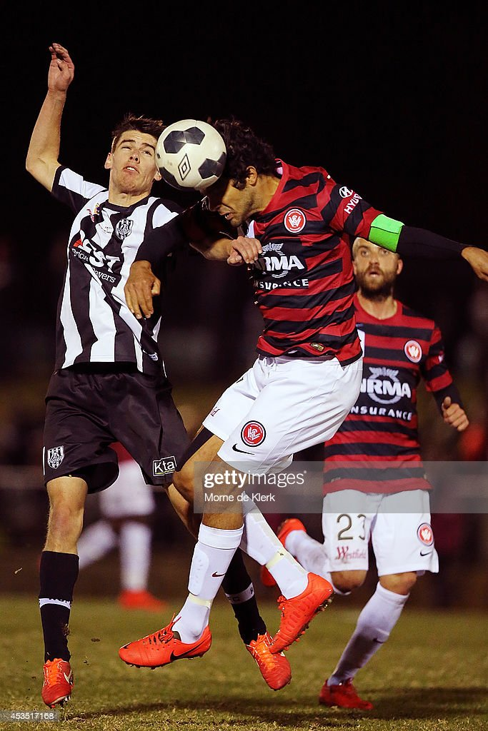 Nokolai Topor-Stanley of Western Sydney competes with Joel Allwright of Adelaide City during the FFA Cup match between Adelaide City and Western Sydney Wanderers at Marden Sports Complex on August 12, 2014 in Adelaide, Australia.