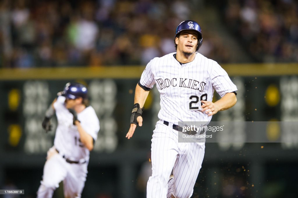 <a gi-track='captionPersonalityLinkClicked' href=/galleries/search?phrase=Nolan+Arenado&family=editorial&specificpeople=7934273 ng-click='$event.stopPropagation()'>Nolan Arenado</a> #28 and Charlie Blackmon #19 of the Colorado Rockies sprint around the bases on a 2-RBI double by teammate Charlie Culberson #23 (not pictured) in the fourth inning of a game against the Cincinnati Reds at Coors Field on August 30, 2013 in Denver, Colorado.