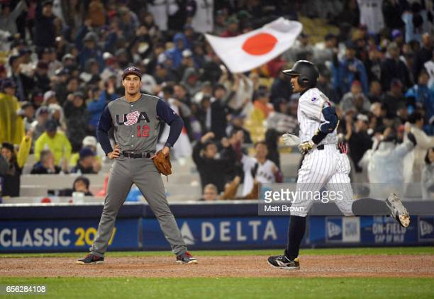 Nolan Arenado of Team USA looks on as Ryosuke Kikuchi of of Team Japan rounds the bases after hitting a solo home run in the sixth inning of Game 2...