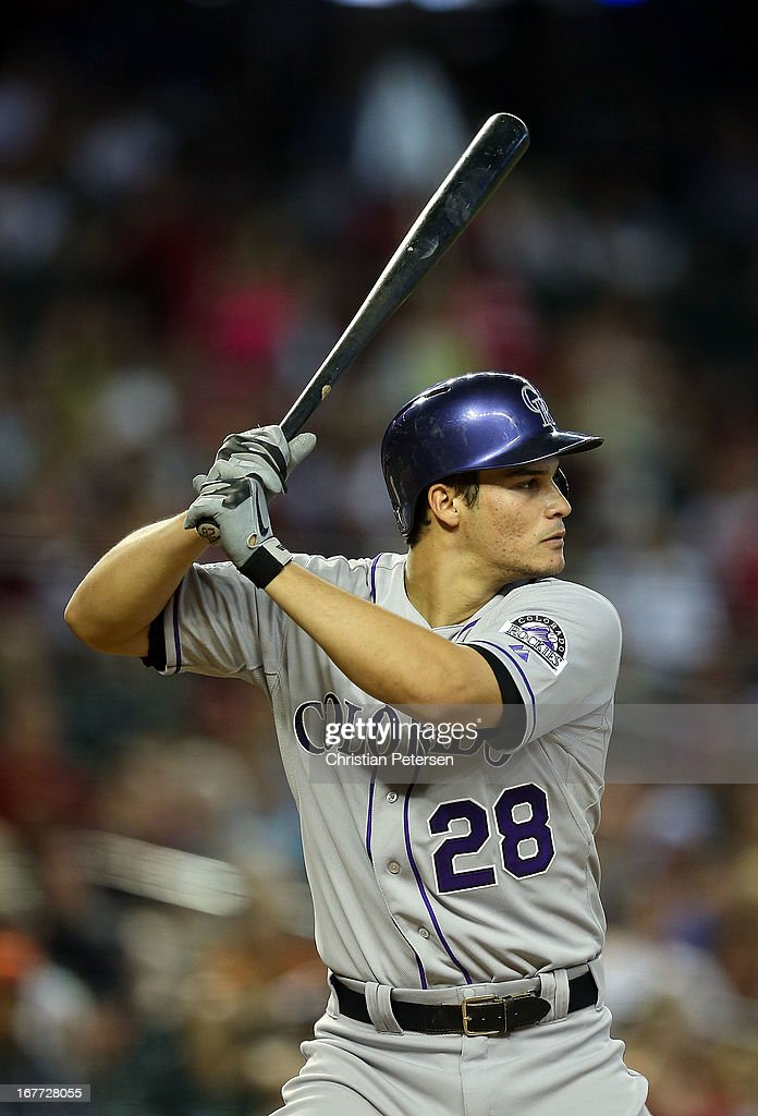 Nolan Arenado #28 of the Colorado Rockies bats against the Arizona Diamondbacks during the MLB game at Chase Field on April 28, 2013 in Phoenix, Arizona.