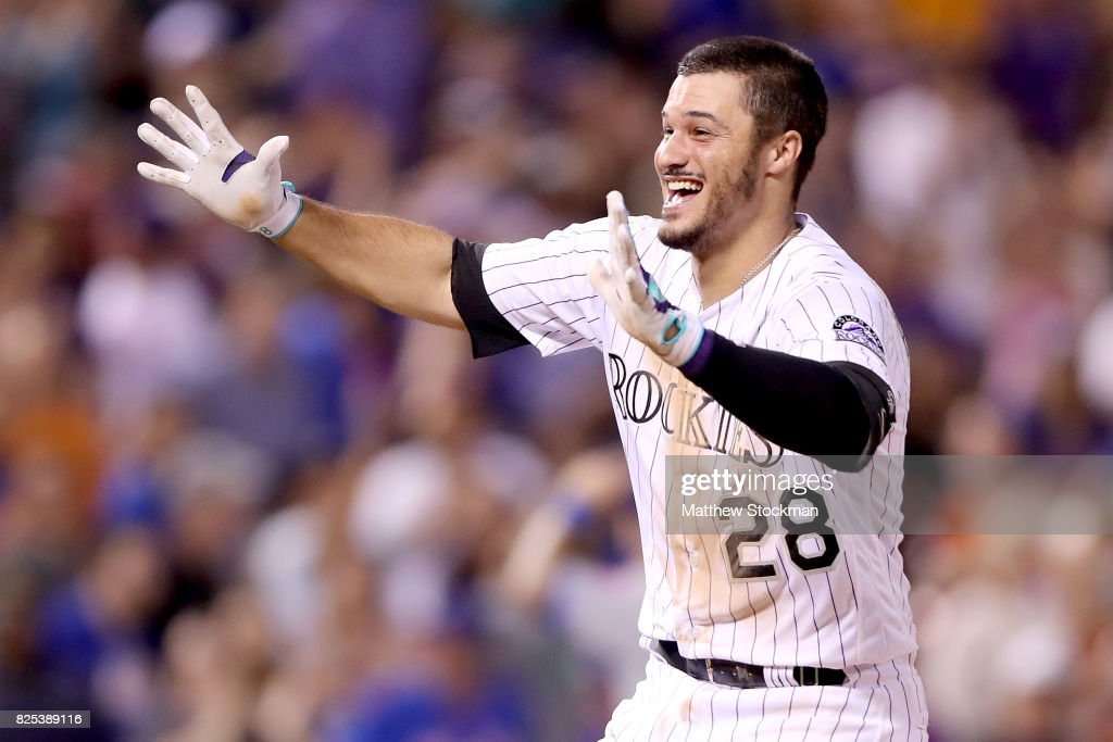 Nolan Arenado #28 of the Colorado Rockies celebrates after driving in the game winning run in the ninth inning against the New York Mets at Coors Field on August 1, 2017 in Denver, Colorado.