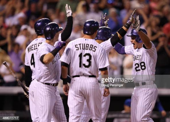 Nolan Arenado of the Colorado Rockies celebrates his grand slam home run off of starting pitcher Jenrry Mejia of the New York Mets with teammates...