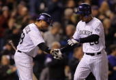 Nolan Arenado of the Colorado Rockies celebrates his solo homerun against the Arizona Diamondbacks with Jordan Pacheco of the Colorado Rockies in the...
