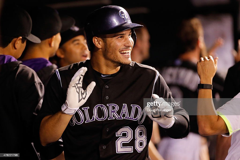 Nolan Arenado #28 of the Colorado Rockies celebrates his three run home run off of Chase Anderson #57 of the Arizona Diamondbacks to give the Rockies a 7-4 lead in the fifth inning at Coors Field on June 23, 2015 in Denver, Colorado.