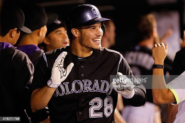 Nolan Arenado of the Colorado Rockies celebrates his three run home run off of Chase Anderson of the Arizona Diamondbacks to give the Rockies a 74...