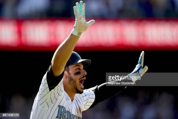 Nolan Arenado of the Colorado Rockies celebrates hitting a 3 RBI walk off home run in the ninth inning against the San Francisco Giants at Coors...
