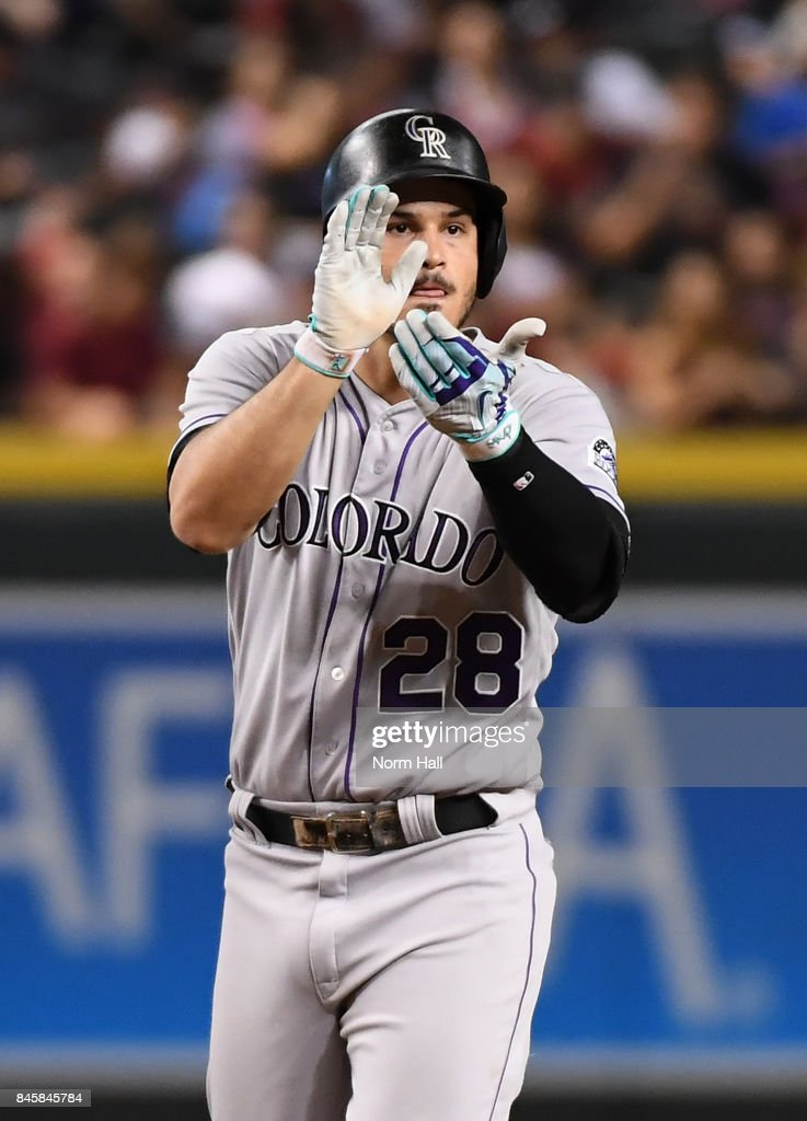 Nolan Arenado #28 of the Colorado Rockies celebrates while standing on second base after hitting an RBI double against the Arizona Diamondbacks during the sixth inning at Chase Field on September 11, 2017 in Phoenix, Arizona. Drury was forced out at first base.