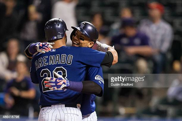 Nolan Arenado of the Colorado Rockies celebrates with Carlos Gonzalez after hitting an 8th inning tworun home run off of Cody Hall of the San...
