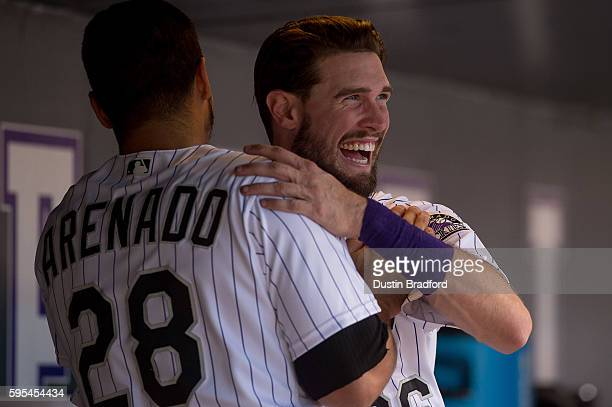 Nolan Arenado of the Colorado Rockies celebrates with David Dahl after hitting a fourth inning 3run homerun his second of the game during a gam...