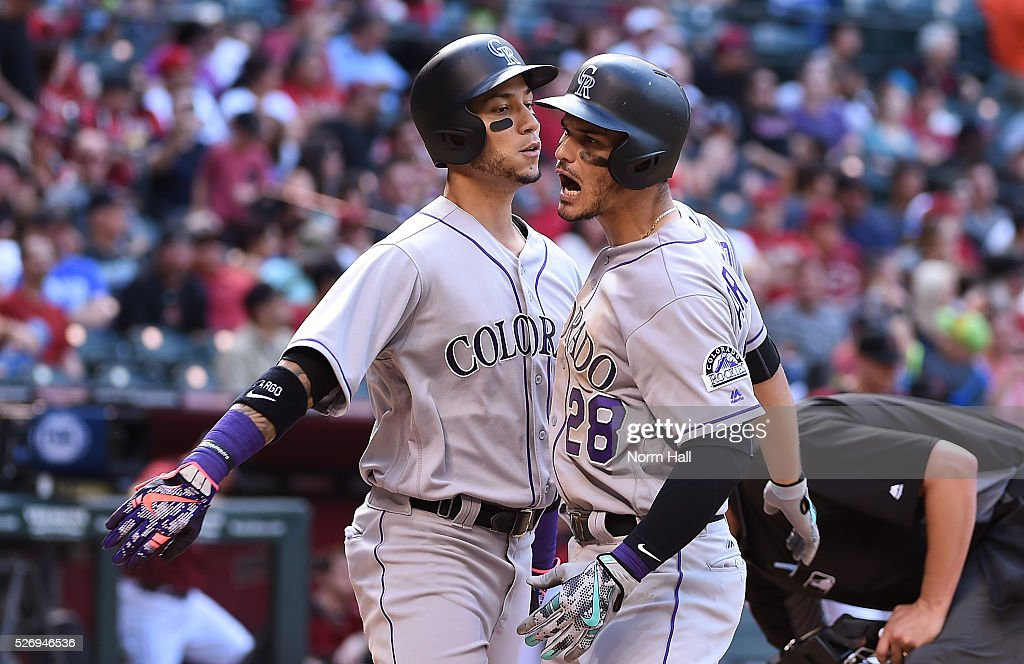 Nolan Arenado #28 of the Colorado Rockies celebrates with teammate Carlos Gonzalez #5 after hitting a two run home run in the seventh inning against the Arizona Diamondbacks at Chase Field on May 01, 2016 in Phoenix, Arizona.