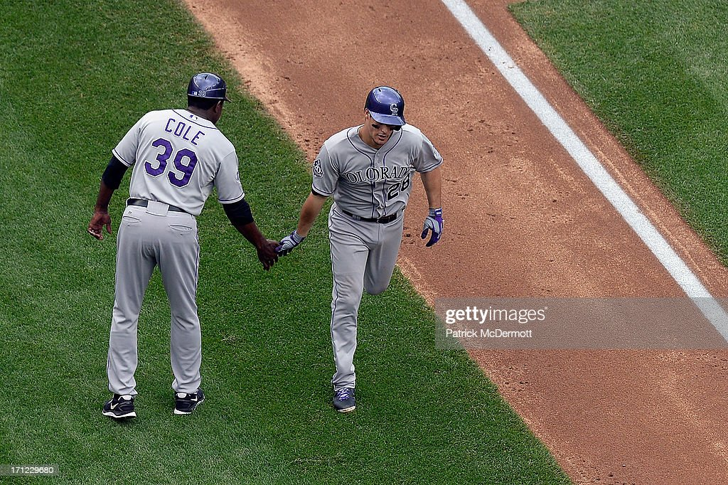 <a gi-track='captionPersonalityLinkClicked' href=/galleries/search?phrase=Nolan+Arenado&family=editorial&specificpeople=7934273 ng-click='$event.stopPropagation()'>Nolan Arenado</a> #28 of the Colorado Rockies celebrates with third base coach Stu Cole #39 after hitting a solo home run in the fourth inning during a game against the Washington Nationals at Nationals Park on June 23, 2013 in Washington, DC.