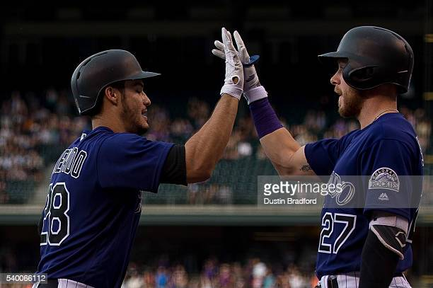 Nolan Arenado of the Colorado Rockies celebrates with Trevor Story after hitting a first inning tworun homerun off of Luis Perdomo of the San Diego...