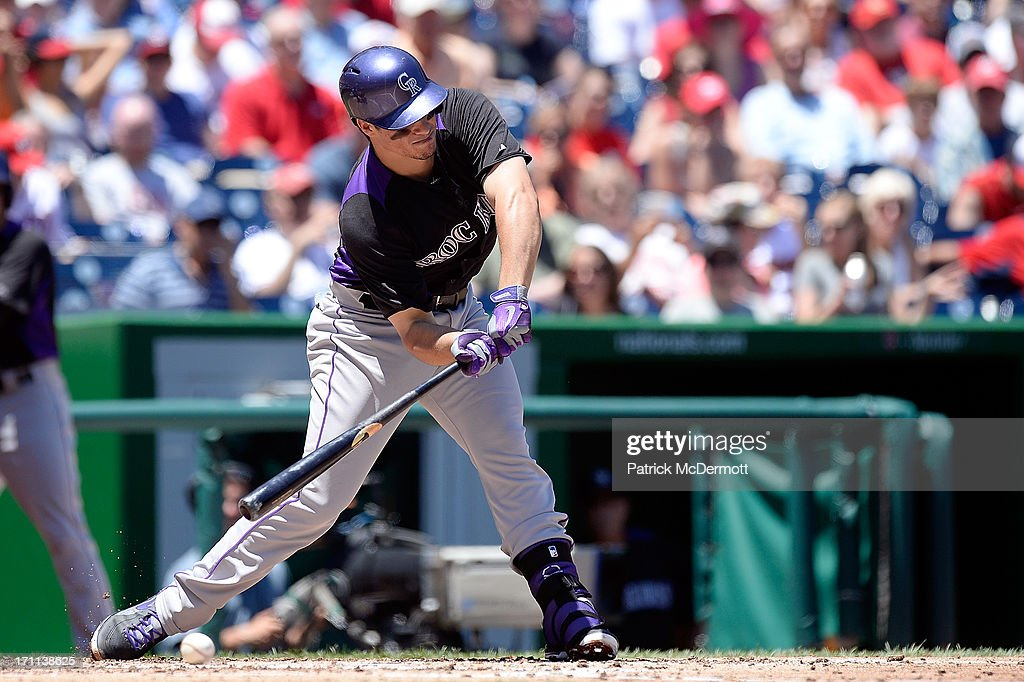 <a gi-track='captionPersonalityLinkClicked' href=/galleries/search?phrase=Nolan+Arenado&family=editorial&specificpeople=7934273 ng-click='$event.stopPropagation()'>Nolan Arenado</a> #28 of the Colorado Rockies checks his swing on a wild pitch by Dan Haren #15 of the Washington Nationals in the fourth inning during a game at Nationals Park on June 22, 2013 in Washington, DC. Wilin Rosario #20 of the Colorado Rockies scored on the play.