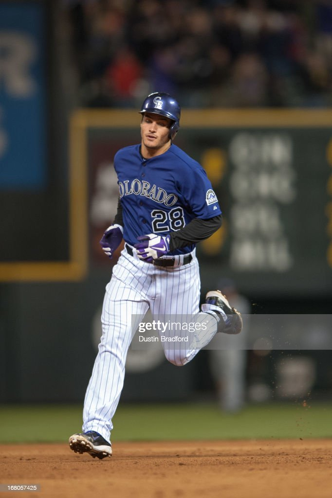 <a gi-track='captionPersonalityLinkClicked' href=/galleries/search?phrase=Nolan+Arenado&family=editorial&specificpeople=7934273 ng-click='$event.stopPropagation()'>Nolan Arenado</a> #28 of the Colorado Rockies circles the bases after hitting a grand slam home run in the seventh inning of a game against the Tampa Bay Rays at Coors Field on May 4, 2013 in Denver, Colorado.