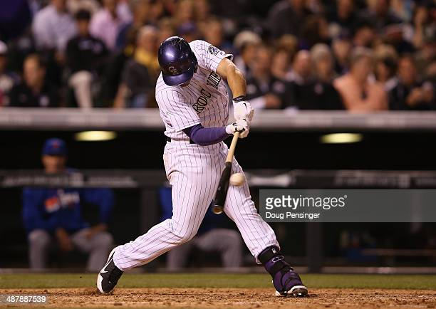 Nolan Arenado of the Colorado Rockies connects for a single off of Carlos Torres of the New York Mets in the seventh inning at Coors Field on May 2...