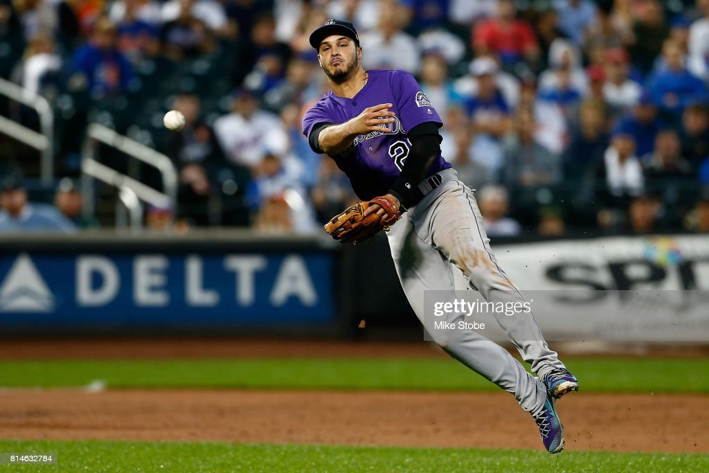 Nolan Arenado #28 of the Colorado Rockies field sth eball for an out in the second inning against the New York Mets at Citi Field on July 14, 2017 in the Flushing neighborhood of the Queens borough of New York City.