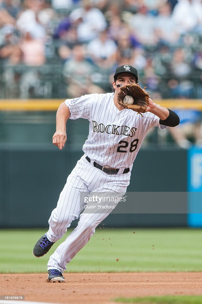 <a gi-track='captionPersonalityLinkClicked' href=/galleries/search?phrase=Nolan+Arenado&family=editorial&specificpeople=7934273 ng-click='$event.stopPropagation()'>Nolan Arenado</a> #28 of the Colorado Rockies fields a ground ball while playing defense at third base against the Arizona Diamondbacks at Coors Field on September 22, 2013 in Denver, Colorado.