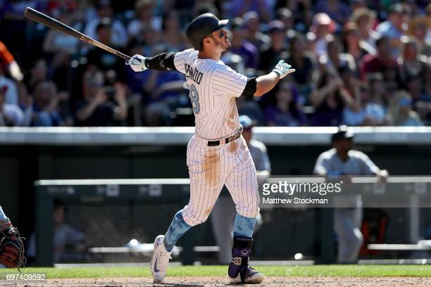 Nolan Arenado of the Colorado Rockies hits a 3 RBI walk off home run in the ninth inning against the San Francisco Giants at Coors Field on June 18...