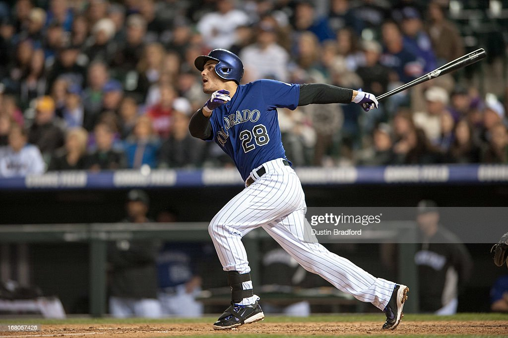 <a gi-track='captionPersonalityLinkClicked' href=/galleries/search?phrase=Nolan+Arenado&family=editorial&specificpeople=7934273 ng-click='$event.stopPropagation()'>Nolan Arenado</a> #28 of the Colorado Rockies hits a grand slam home run in the seventh inning of a game against the Tampa Bay Rays at Coors Field on May 4, 2013 in Denver, Colorado.
