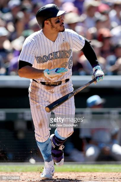 Nolan Arenado of the Colorado Rockies hits a RBI double in the sixth inning against the San Francisco Giants at Coors Field on June 18 2017 in Denver...