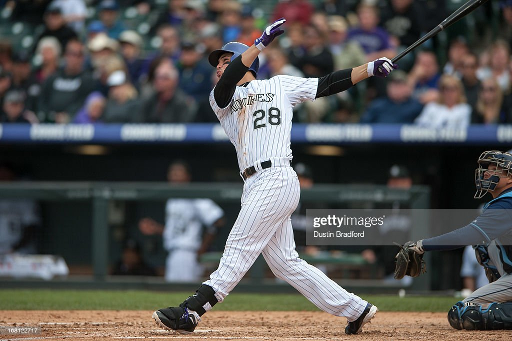 <a gi-track='captionPersonalityLinkClicked' href=/galleries/search?phrase=Nolan+Arenado&family=editorial&specificpeople=7934273 ng-click='$event.stopPropagation()'>Nolan Arenado</a> #28 of the Colorado Rockies hits a solo home run in the seventh inning of a game against the Tampa Bay Rays at Coors Field on May 5, 2013 in Denver, Colorado.