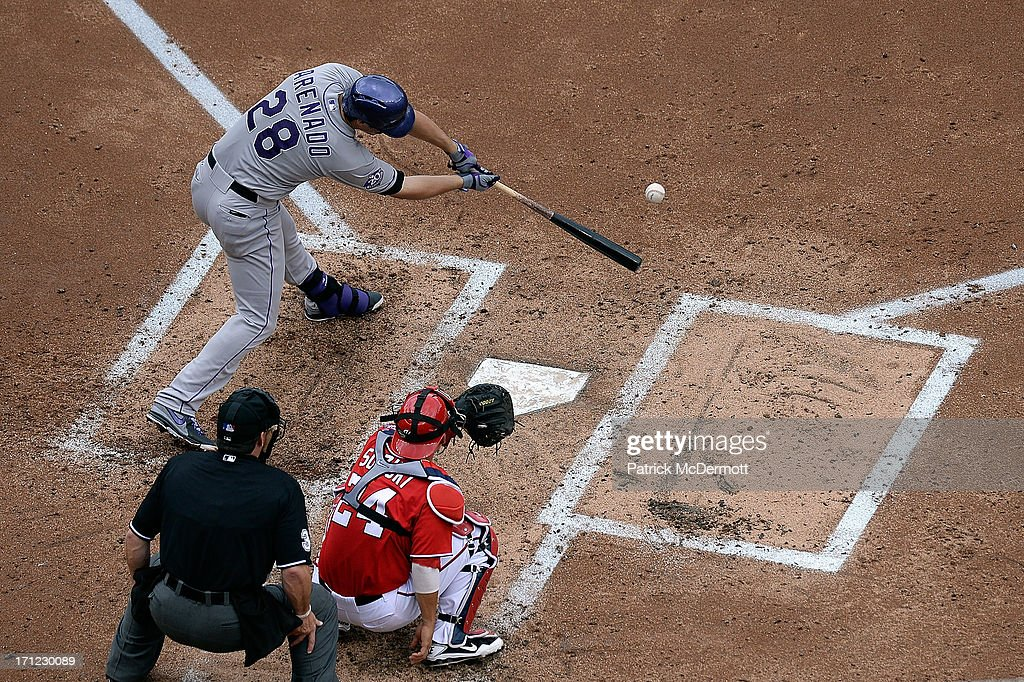 <a gi-track='captionPersonalityLinkClicked' href=/galleries/search?phrase=Nolan+Arenado&family=editorial&specificpeople=7934273 ng-click='$event.stopPropagation()'>Nolan Arenado</a> #28 of the Colorado Rockies hits a solo home run in the fourth inning during a game against the Washington Nationals at Nationals Park on June 23, 2013 in Washington, DC.