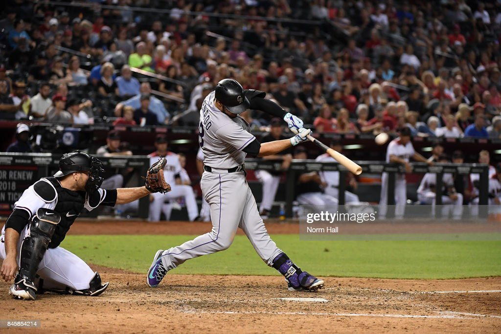 Nolan Arenado #28 of the Colorado Rockies hits a three run home run off of Jake Barrett #33 of the Arizona Diamondbacks during the eighth inning at Chase Field on September 11, 2017 in Phoenix, Arizona.