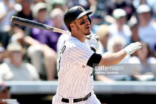 Nolan Arenado of the Colorado Rockies hits a two RBI double in the third inning against the Cleveland Indians at Coors Field on June 7 2017 in Denver...