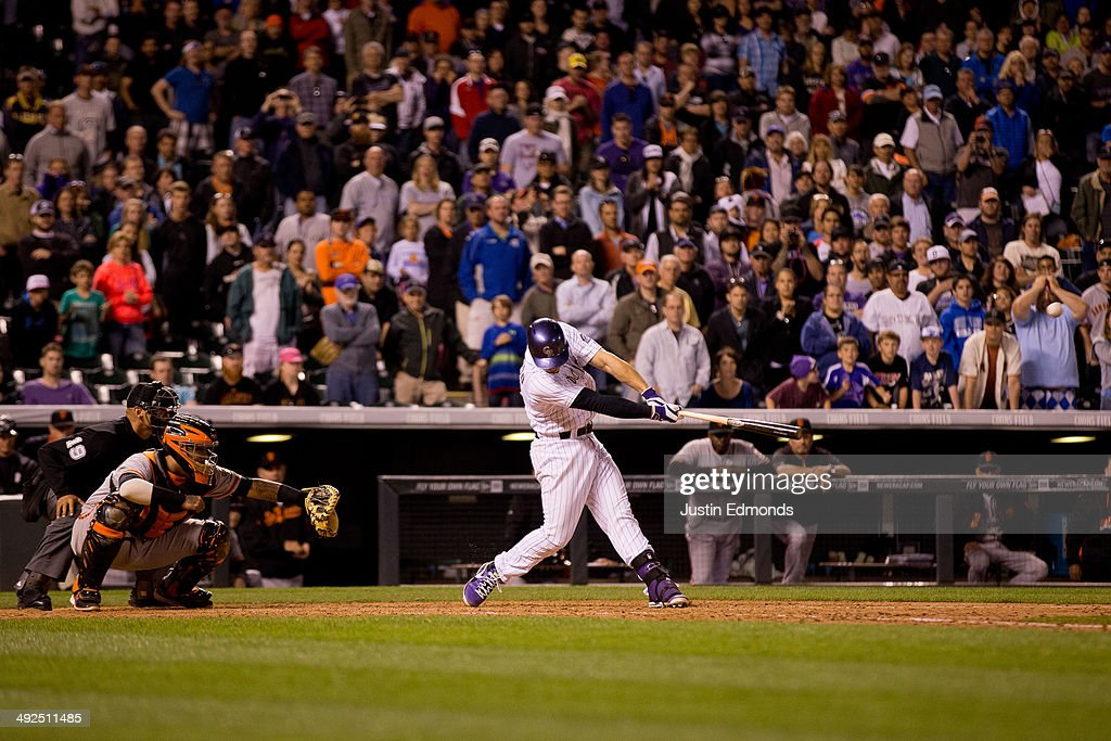 Nolan Arenado #28 of the Colorado Rockies hits a walk off single that scored two runs during the ninth inning against the San Francisco Giants at Coors Field on May 20, 2014 in Denver, Colorado. The Rockies defeated the Giants 5-4 on a walk off hit by Nolan Arenado #28.
